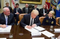 President Donald J. Trump signs Executive Order Promoting Agriculture and Rural Prosperity in America with Secretary of Agriculture, Sonny Perdue, in the Roosevelt Room of the White House in Washington, D.C., Tuesday, April 25th, 2017. It's questionable though if in the long run the new NAFTA leaves the US farmers better off. (Official White House photo by Shealah Craighead).